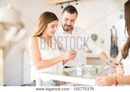 Young Couple Looking At Engagement Rings