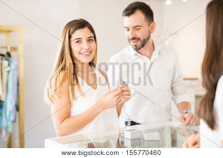 Happy Woman Buying A Diamond Ring