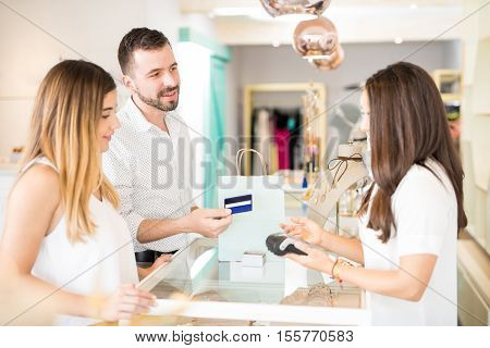 Man Paying For Some Jewelry For His Wife