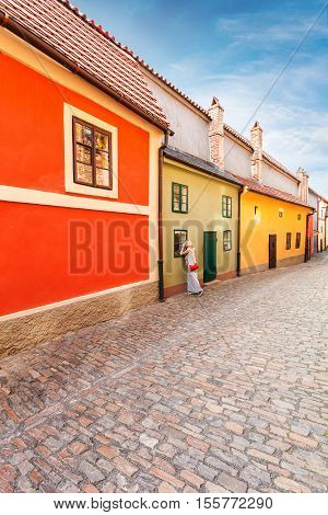 Golden street inside of Old Royal Palace in Prague, Czech Republic. Multicolored houses authentic retro.