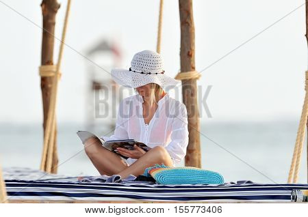 young woman outdoor in summer, reading