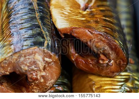 Set of smoked fish in a tin pan. Smoked mackerel