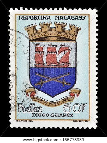 MADAGASCAR-CIRCA 1965 : Cancelled postage stamp printed by Madagascar, that shows Arms of Diego Suarez.