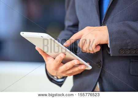 Man In Suit Keeping Notes