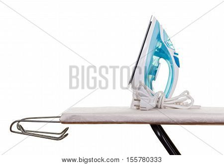 Electric steam iron and ironing board isolated on white background.
