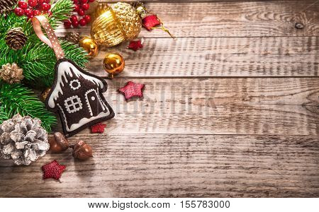 Christmas decoration top view fir pinecone acorn star on old wooden board rustic style fairy-tale winter home greetings holiday card. Copyspace