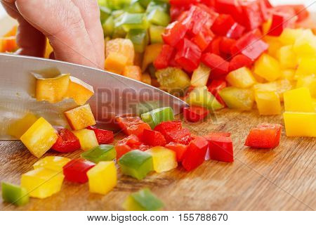 Cutting Bell Pepper. Cook chopped vegetables on a board for cutting