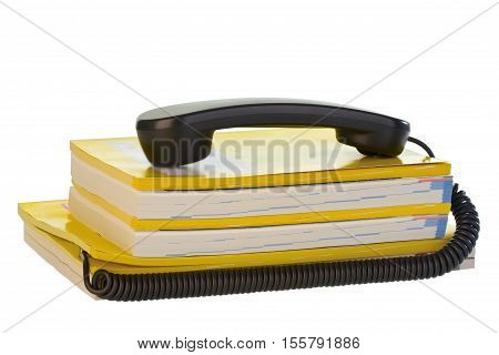 Telephone Receiver with phone book on bright background
