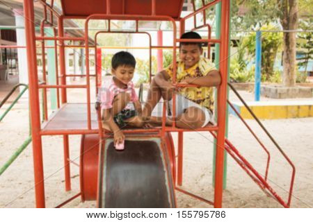 Blurry of cute child asian boy play at playground