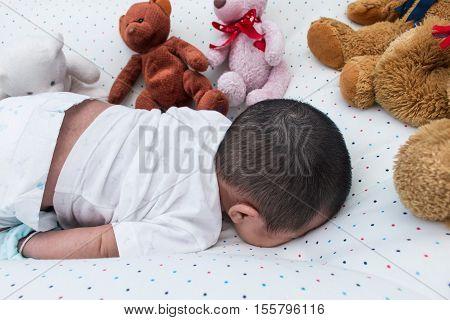 Cute asian little girl newborn sleeping prone