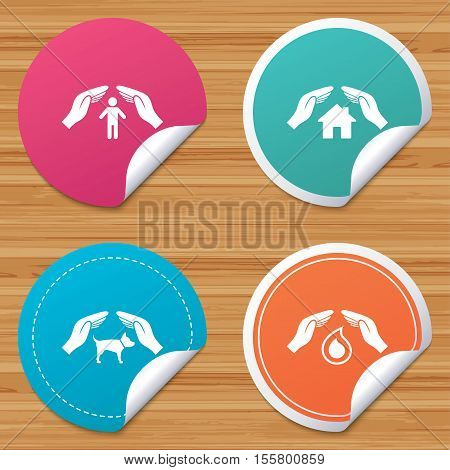 Round stickers or website banners. Hands insurance icons. Shelter for pets dogs symbol. Save water drop symbol. House property insurance sign. Circle badges with bended corner. Vector