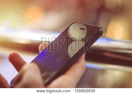 Man using smart phone close up. Mobile phone in hand