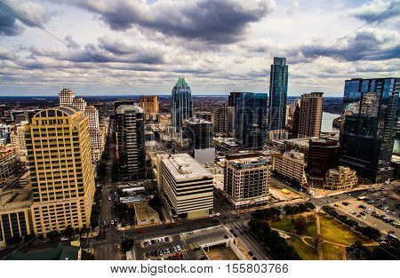 Dramatic High contrast Aerial Shot Austin Texas Skyline Cityscape in the center of Downtown with Frost Bank tower and the Tall Austonian in view with office buildings