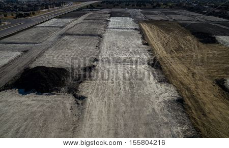Aerial View Over Stripped Landscape , un-earthed , Environmental Damage. A Turn Landscape from the destruction on construction. Apocalyptic wasteland of the Industrial Revolution outside of Austin , Texas