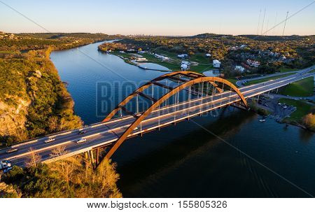 Pennybacker Bridge or 360 Bridge Sunset Evening over Colorado River Austin Texas hill country in the background colorado river