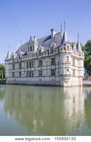 LOIRE FRANCE - JUNE 16: Azay le Rideau castle with its moat in the Loire Valley on June 16 2014 France. This castle was built in the XVIth century on an island among the Indre river.