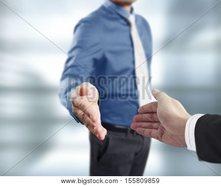 Business handshake with business people