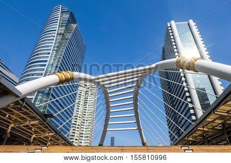 Chong Nonsi Skywalk and BTS Station with modern buildings in Bangkok, Thailand