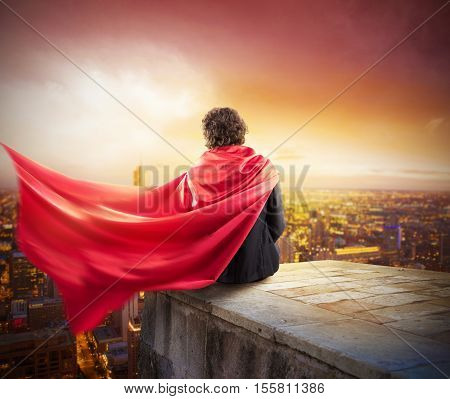 Man with cloak view from above the city