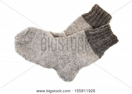 isolated on white background gray socks made of wool at home
