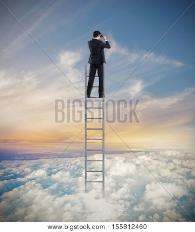 Man on a ladder high into the sky watching with binoculars