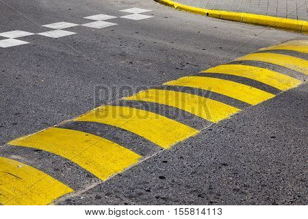 photographed close-up of road marking is located on the roadway,