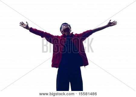 Backlit outstretched arms man
