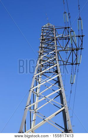 photographed electric poles situated in the daytime, industrial buildings