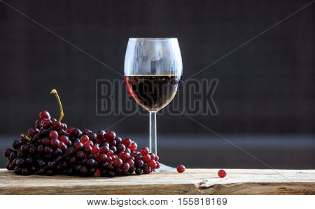 Red Grapes And A Glass Of Wine
