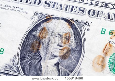 old bill one US dollar covered with rust spots. Photo closeup
