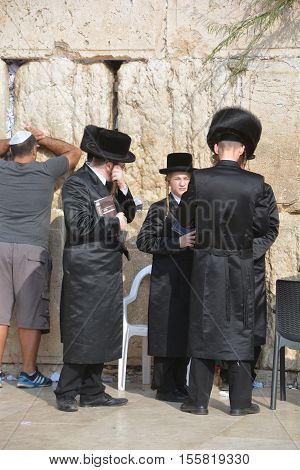 JERUSALEM ISRAEL 26 10 16: Jewish hasidic pray a the Western Wall, Wailing Wall the Place of Weeping is an ancient limestone wall in the Old City of Jerusalem. Second Jewish Temple by Herod the Great