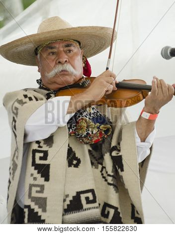 PUEBLA, PUEBLA, MEXICO - OCTOBER 2, 2016: Violinist performing at the stage in Puebla, Puebla, Mexico