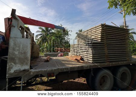 Stack of prestressed concrete slabs loaded on truck for construction