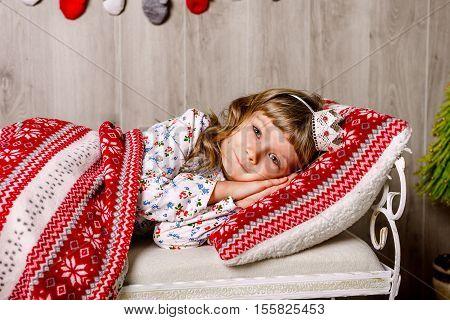 Christmas. child fell asleep near the Christmas tree waiting for Santa Claus