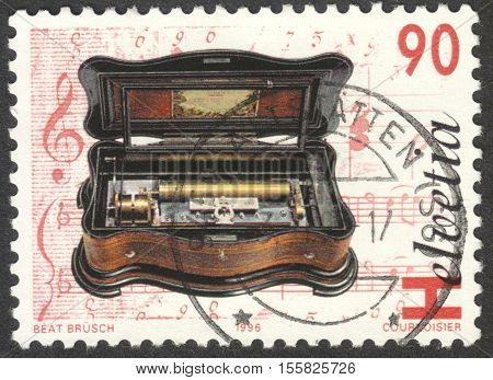 MOSCOW RUSSIA - CIRCA OCTOBER 2016: a post stamp printed in SWITZERLAND shows Cylinder music box