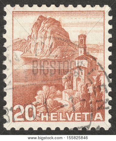 MOSCOW RUSSIA - CIRCA OCTOBER 2016: a post stamp printed in SWITZERLAND shows Church of St George in Castagnoli Lugano Canton Ticino the series
