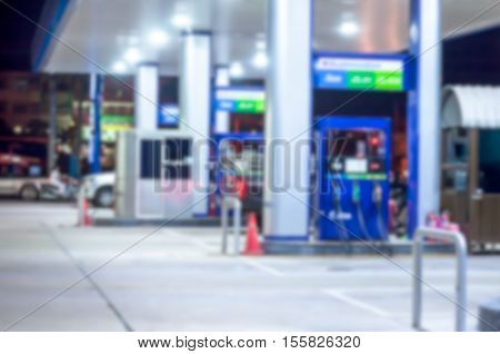 The Blurred Of Car .filling Station With Bokeh Light Background