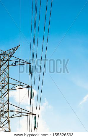 half of High voltage transmission lines isolated on blue sky background poster