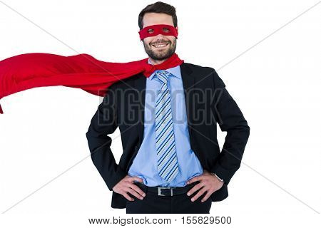 Portrait of businessman pretending to be a super hero Businessman pretending to be a super hero against white background