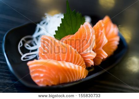 Sliced salmon sashimi Japanese raw food delicious menu famous fish from Norway