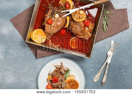 Braised beef with tomatoes lemon garlic and rosemary in pot. Beef meat stew. Delicious and healthy dinner