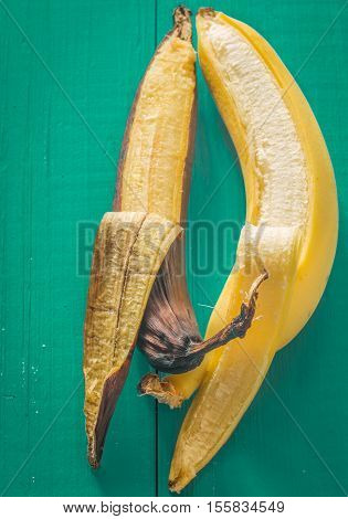 Fresh And Rotten Banana On Wooden Background