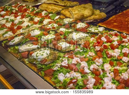Gourmet Pizzas sold in a local Italian pizzeria.