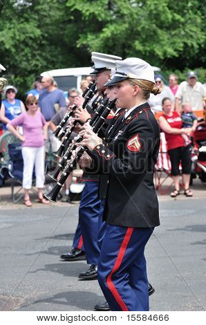 The Usmc Marine Forces Reserve Band Performers Playing Clarinets In A Parade