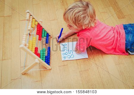 home school learning homework concept -little boy learning numbers at home
