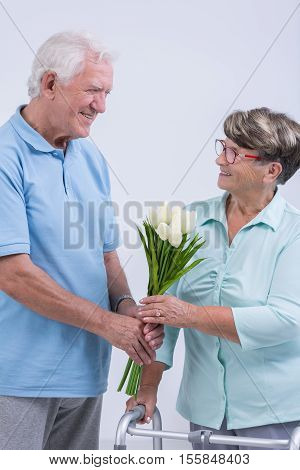 Old Man Giving Flowers