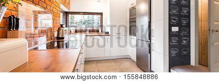 Minimalist Kitchen With White Cabinets