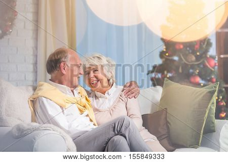Senior Marriage Sitting On Sofa