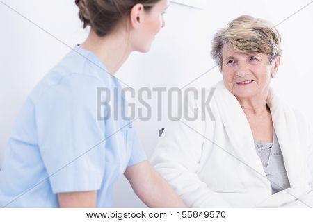 Elder Woman Talking With Her Female Caregiver