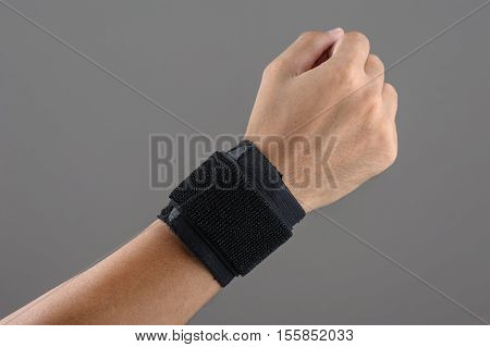 closeup hand with wrist support, sport and medical equipment